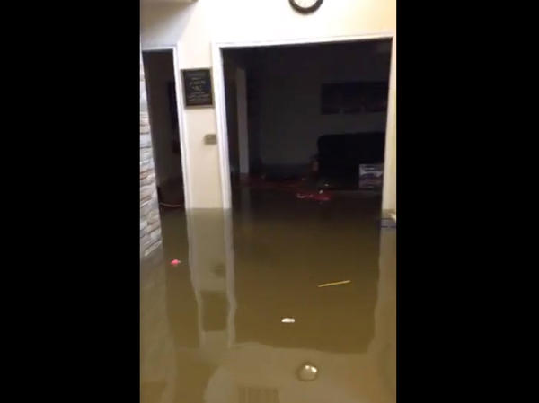 "A screenshot from Mayor Derrick Harvey's Facebook livestream on Wednesday. ""We got some water, y'all. Harvey wasn't playing,"" the Mayor says in a video that shows knee-deep water inside his house."