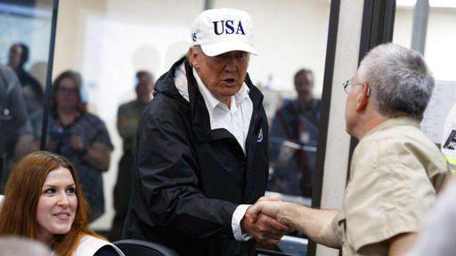 President Trump is greeted as he tours the Texas Department of Public Safety Emergency Operations Center on Tuesday in Austin.