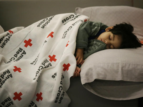 Malachia Medrano, 2, sleeps at the George R. Brown Convention Center in Houston, which has been set up as a shelter for people escaping the floodwaters from Hurricane Harvey.