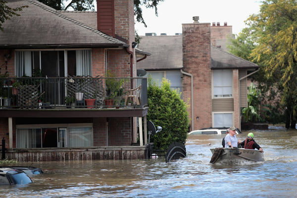 Rescue workers and volunteers help to rescue residents of an apartment complex after it was inundated with water following Hurricane Harvey on Wednesday in Houston, Texas.