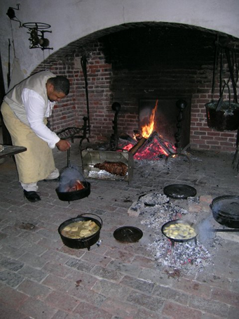 """Twitty cooks in plantation kitchens to convey to others the story and legacy of African Americans in the South. His approach is not that of a historian, but rather a """"historical interpreter."""""""
