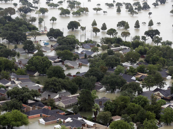 Homes are flooded near the Addicks Reservoir as floodwaters from Tropical Storm Harvey rose on Tuesday in Houston.