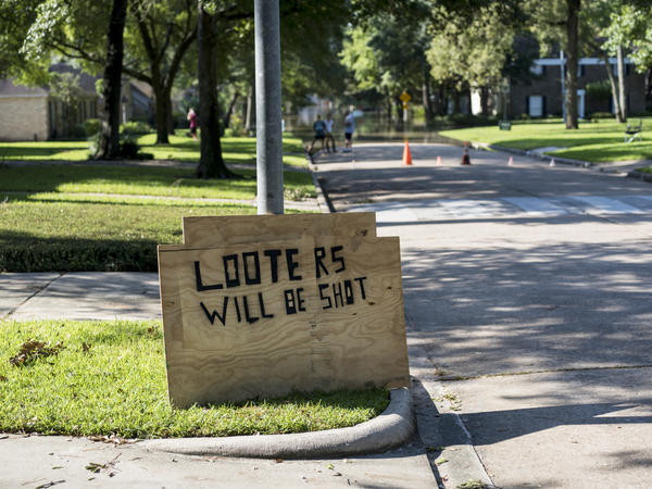 A sign warns against looting in the Nottingham Forrest subdivision. Local and state officials have vowed to crack down on anyone who victimizes the flood victims.