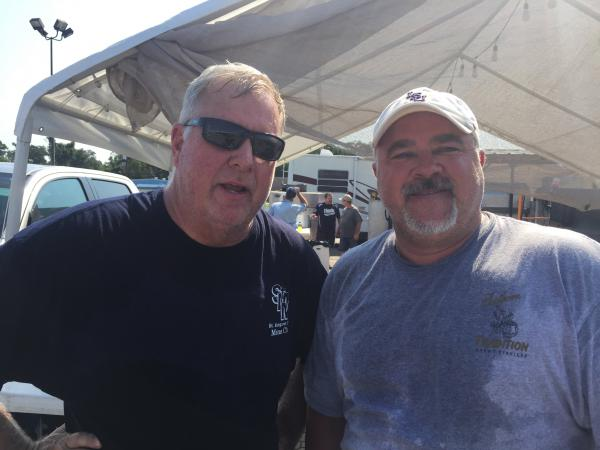 "Bill Borchert (L) and Troy Hueschen are helping coordinate a makeshift kitchen to cook for victims and responders. ""We been through it with Katrina so we here to serve the people,"" Hueschen says."
