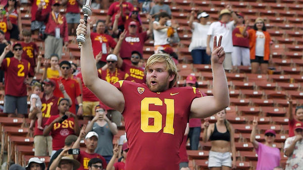 USC long snapper Jake Olson leads the Trojan Marching Band following a victorious game against Western Michigan on Saturday.