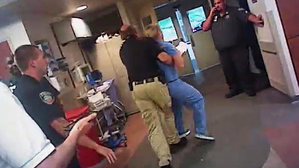 A frame grab from video taken from a police body camera shows the July 26 arrest of nurse Alex Wubbels at the University of Utah Hospital in Salt Lake City. The image was provided by Wubbels' attorney, Karra Porter.