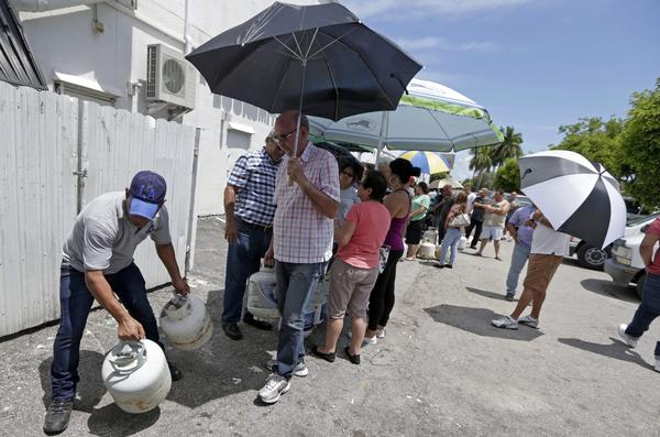 Residents stand in line to purchase propane gas as they prepare for Hurricane Irma, Tuesday, Sept. 5, 2017, in Hialeah, Fla. Hurricane Irma grew into a dangerous Category 5 storm, the most powerful seen in the Atlantic in over a decade, and roared toward islands in the northeast Caribbean Tuesday on a path that could eventually take it to the United States. (Alan Diaz/AP)