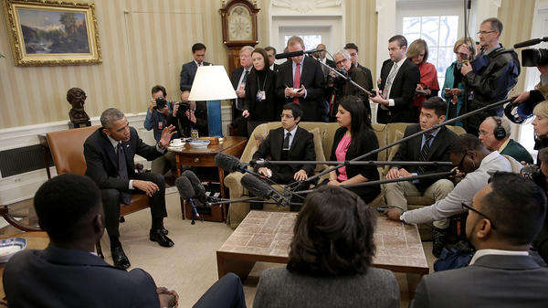 Then-President Barack Obama in a 2015 meeting with a group of DREAMers, who received protection from Deferred Action for Childhood Arrivals. Obama reacted strongly to President Trump's reversal of the policy.