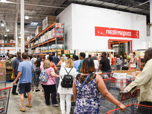People wait in line at Costco for bottled water in preparation for Hurricane Irma on Tuesday in North Miami. The governors of both Puerto Rico and Florida declared states of emergency.