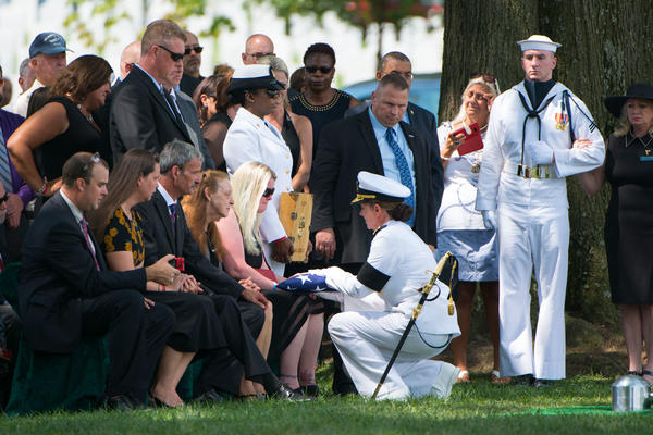 Erin Rehm receives the American flag from Vice Adm. Jan Tighe during the graveside service for her husband, U.S. Navy Fire Controlman 1st Class Gary Rehm Jr. at Arlington National Cemetery on Aug. 16. He was one of seven sailors killed on June 17 when the USS Fitzgerald collided with a cargo ship off the coast of Japan. A Navy report says Rehm helped rescue one of his shipmates.