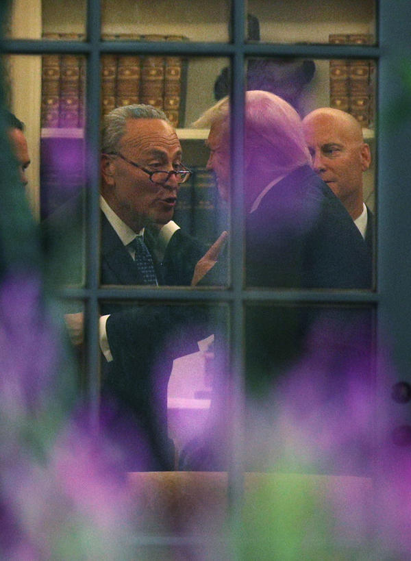 Senate Minority Leader Chuck Schumer, D-N.Y., makes a point to President Trump in the Oval Office after their White House meeting on Wednesday.