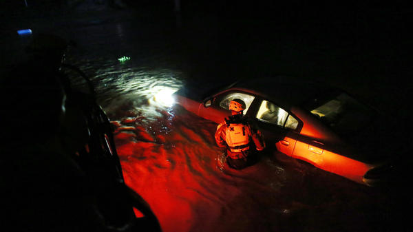 A rescue team from the local emergency management agency inspects flooded areas late Wednesday in Fajardo, Puerto Rico, after the passing of Hurricane Irma. The category 5 storm is expected to make landfall in Florida by the weekend.