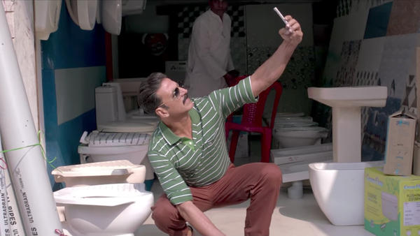 This selfie is in the toilet: Actor Akshay Kumar poses with the object of his bride's affection in the new movie <em>Toilet: A Love Story</em>.