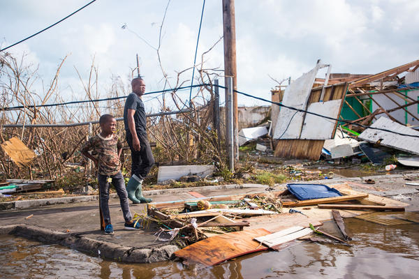 People take in the damage from Hurricane Irma in Marigot on the island of St. Martin on Thursday.