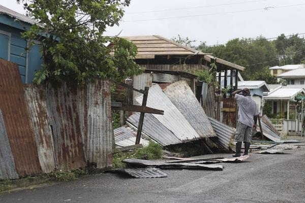 A man surveys the wreckage on his property after the passing of Hurricane Irma, in St. John's, Antigua and Barbuda, Wednesday, Sept. 6, 2017. Heavy rain and 185-mph winds lashed the Virgin Islands and Puerto Rico's northeast coast as Irma, the strongest Atlantic Ocean hurricane ever measured, roared through Caribbean islands on its way to a possible hit on South Florida. (Johnny Jno-Baptiste/AP)