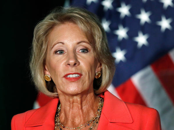 "Education Secretary Betsy DeVos speaks about campus sexual assault and enforcement of Title IX on Thursday at George Mason University in Arlington, Va. ""One rape is one too many ... one person denied due process is one too many,"" she said."