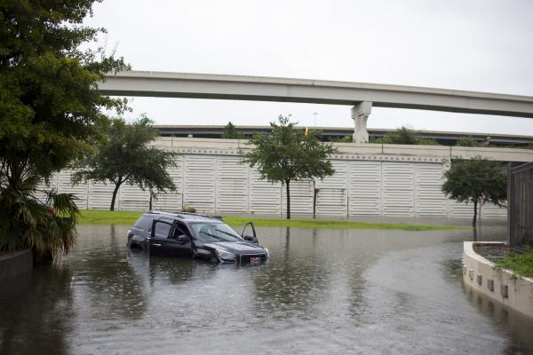 A car is left stranded in Houston on Aug. 27.