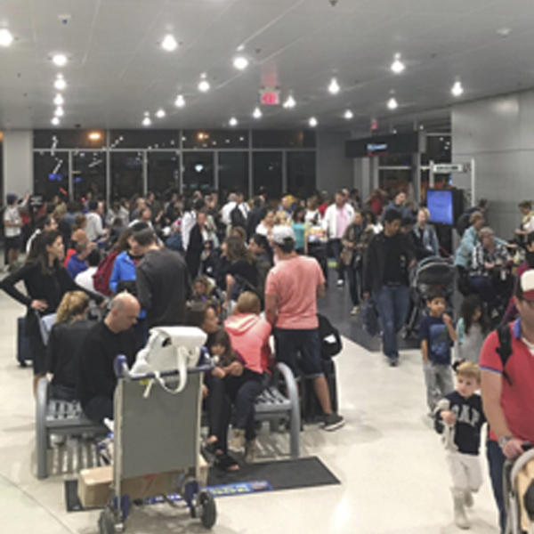 Miami's airport is packed on Thursday as residents and tourists evacuate the southern part of the state.