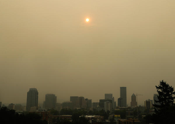 The sun was barely visible over downtown Portland on Wednesday because of wildfires burning east of the city in the Columbia River Gorge.