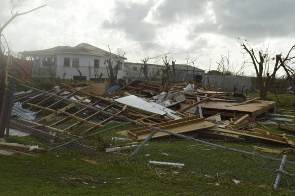 In this Thursday, Sept. 7, 2017, photo, damage is left after Hurricane Irma hit Barbuda. Hurricane Irma battered the Turks and Caicos Islands early Friday as the fearsome Category 5 storm continued a rampage through the Caribbean that has killed a number of people, with Florida in its sights. (Anika E. Kentish/AP)