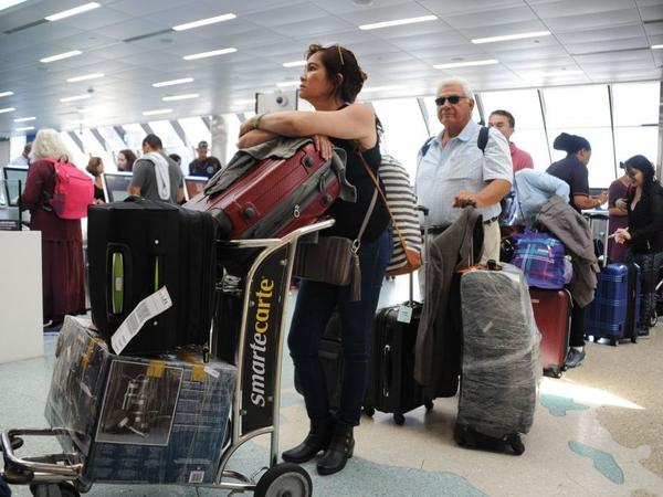 People crowd Fort Lauderdale-Hollywood International Airport as evacuation is underway on Thursday.