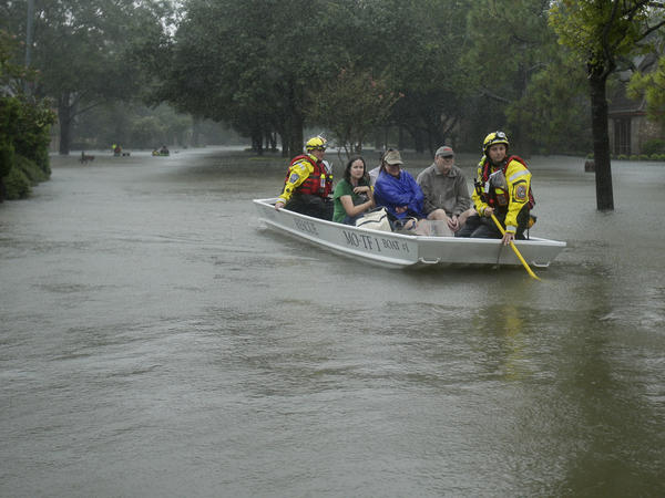 A FEMA rescue team evacuates people from a neighborhood inundated by floodwaters from Hurricane Harvey late last month in Houston.
