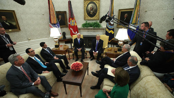President Donald Trump and Vice President Mike Pence meet with: (clockwise from lower left) House Majority Leader Rep. Kevin McCarthy, R-Calif.; Treasury Secretary Steven Mnuchin; Speaker of the House Paul Ryan, R-Wisc.; Senate Majority Leader Mitch McConnell, R-Ky.; Senate Minority Leader Chuck Schumer, D-N.Y.; and House Minority Leader Nancy Pelosi, D-Calif., in the Oval Office on Wednesday.