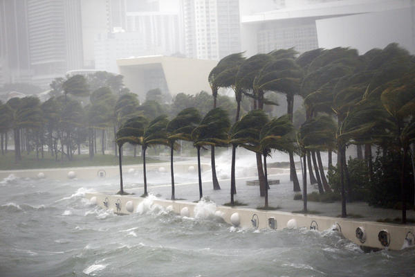 Waves crash over a seawall from Biscayne Bay as Hurricane Irma passes by, Sunday, Sept. 10, 2017, in Miami. (Wilfredo Lee/AP)