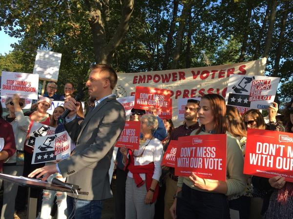 Protesters, including former Missouri Secretary of State Jason Kander, outside the election commission's hearing in Manchester, N.H., on Tuesday. They say the panel is stacked with members who believe that voter fraud is extensive and will use its conclusions to push for more restrictive voter laws.