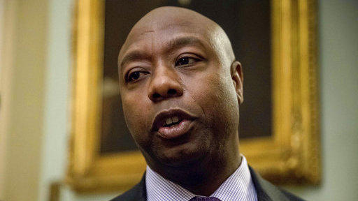 In a Nov. 16, 2016 file photo, Sen. Tim Scott, R-S.C., speaks to members of the media as he arrives for a closed-door Republican policy luncheon on Capitol Hill in Washington.