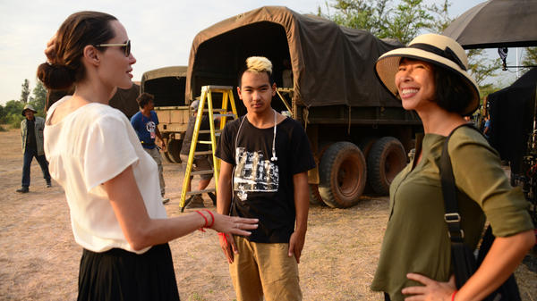 Jolie (left) and Ung (right) worked together to film <em>First</em> <em>They Killed My Father</em> in Cambodia. (Also pictured: Jolie's son, Maddox Jolie-Pitt, center.)