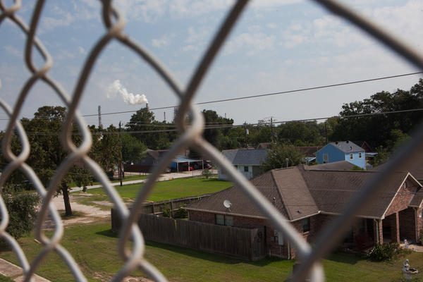 A smokestack rises in the background over the East Houston community of Manchester, <strong></strong><strong></strong>Texas, where the air was heavy with what smelled like gasoline after Hurricane Harvey in late August. The neighborhood is ringed by industrial sites.