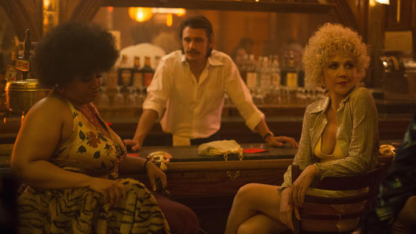 <em>The Deuce</em> takes place in 1970s New York, as pornography is becoming legal. (Pictured: Pernell Walker, James Franco and Maggie Gyllenhaal.)