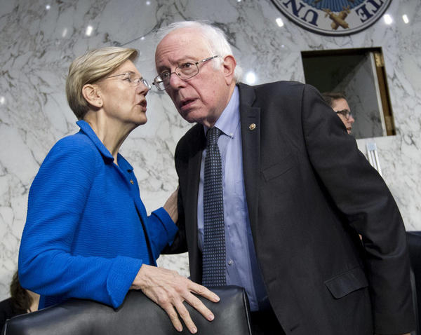 Sen. Elizabeth Warren, D-Mass. speaks with Sen. Bernie Sanders, I-Vt. at the Senate Health, Education, Labor, and Pensions Committee hearing with governors to discuses ways to stabilize health insurance markets​, on Capitol Hill in Washington on Sept. 7. (Jose Luis Magana/AP)