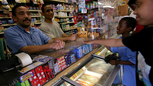 "Jesus Martinez (L) works at his bodega grocery store in the Queens borough of New York City in 2007. Tech entrepreneurs got pushback for calling their startup ""Bodega."""
