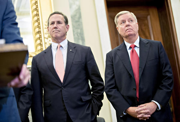 Sen. Lindsey Graham, R-S.C. (right), and Rick Santorum, former senator from Pennsylvania, listen during a health reform news conference on Capitol Hill last week.