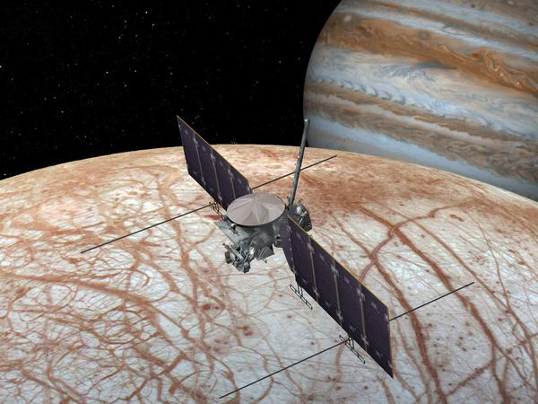 An artist's rendition of the future Europa Clipper probing Jupiter's moon Europa for potential life.