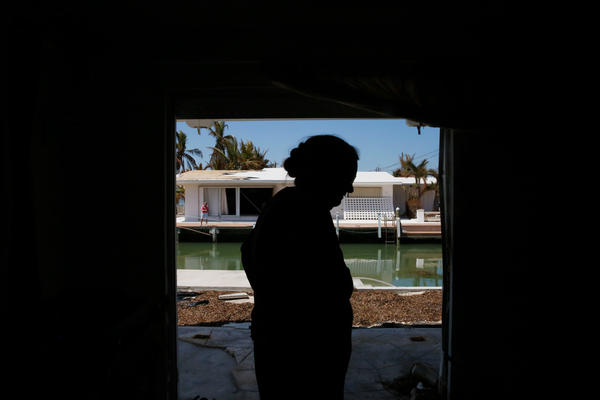 Laura Welliver walks through her home, surveying the damage.
