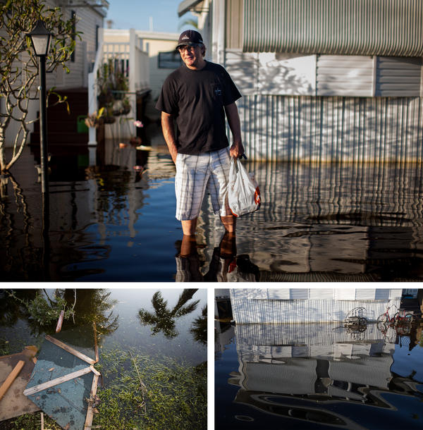 Gary van Gorp carries food home through floodwaters in his neighborhood in Fort Myers, Fla. The waters remained for six days after Hurricane Irma hit.