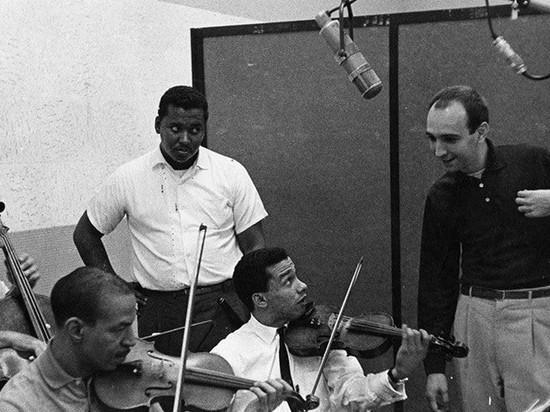 Brazilian composer Joāo Donato rehearses an orchestra in a Los Angeles recording studio in the 1960's.