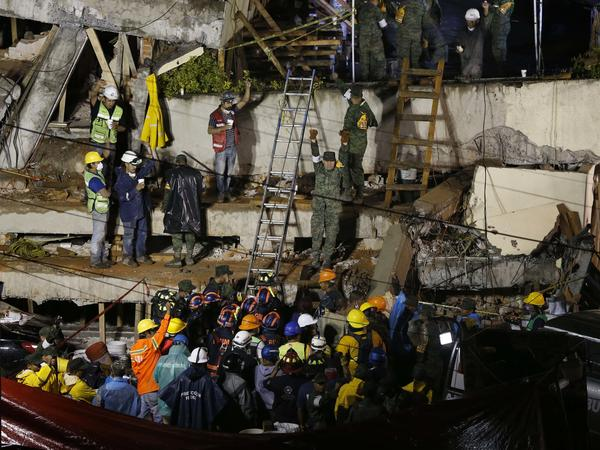 Rescue crews try to free a trapped child at the Enrique Rebsamen primary school in Mexico City on Wednesday after a powerful earthquake jolted central Mexico a day earlier.