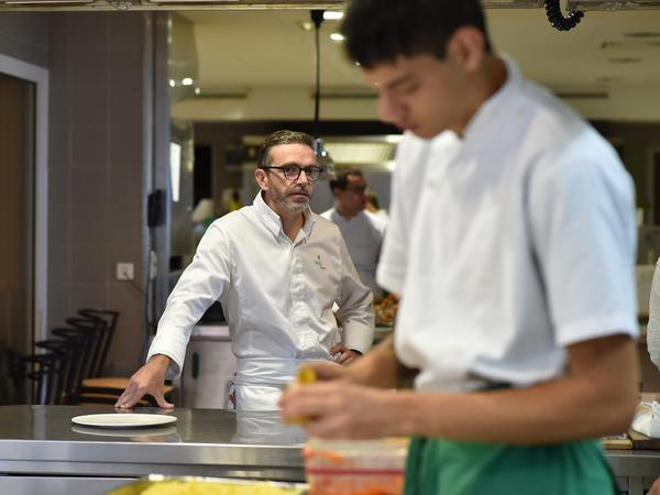 Acclaimed chef Sebastien Bras stands in the kitchen of his three-star restaurant Le Suquet, in Laguiole, France, on Thursday. This week he asked not to be included in the 2018 Michelin Guide.