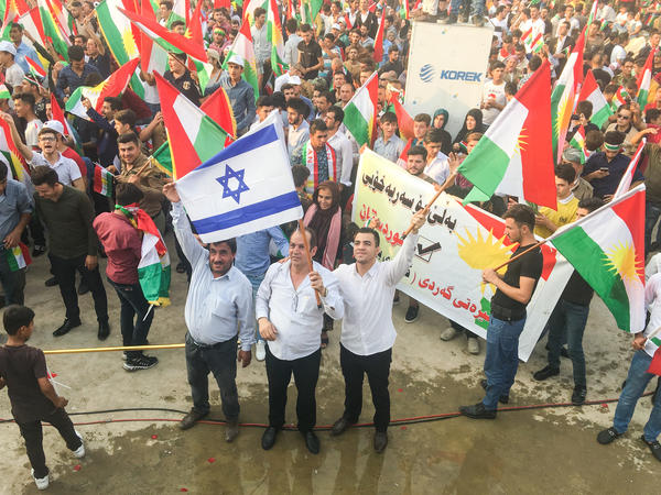 Kurds wave Israeli flags at a Kurdish independence rally. Israel is the only country in the region to support the referendum.