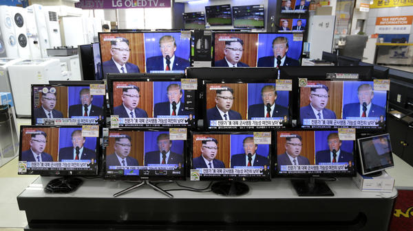 TV screens at a store in Seoul, South Korea, show news coverage of the latest exchange of insults between President Trump and North Korean leader Kim Jong Un.