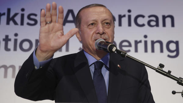 Turkey's President Recep Tayyip Erdogan addresses a Turkish-American meeting in New York, Thursday. Protesters disrupted his speech before being ejected from the hall.