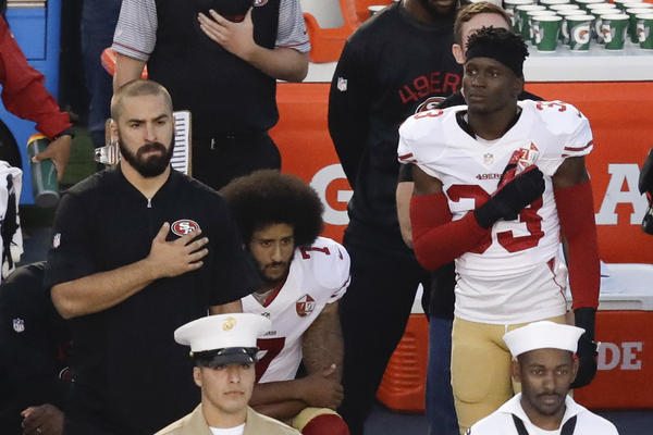 In this Thursday, Sept. 1, 2016 file photo, San Francisco 49ers quarterback Colin Kaepernick, middle, kneels during the national anthem before the team's NFL preseason football game against the San Diego Chargers. (Chris Carlson/AP)