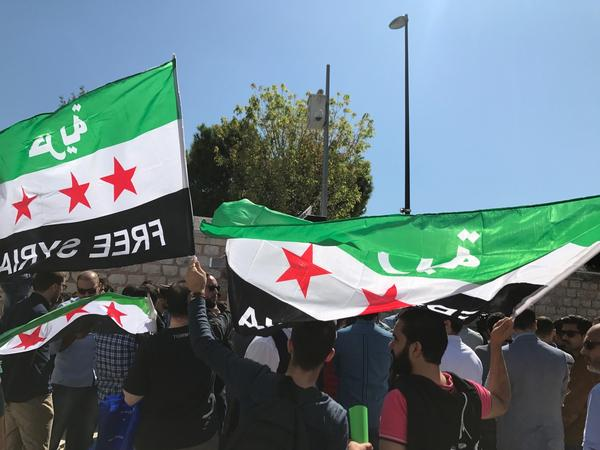 Mourners join the funeral procession for the Barakats on Saturday. Orouba was a member of the Syrian National Coalition, a political opposition group.