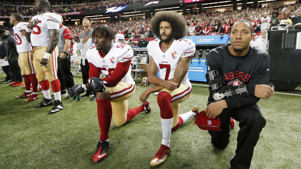 San Francisco 49ers quarterback Colin Kaepernick and outside linebacker Eli Harold kneel during the playing of the national anthem before an NFL game in 2016.