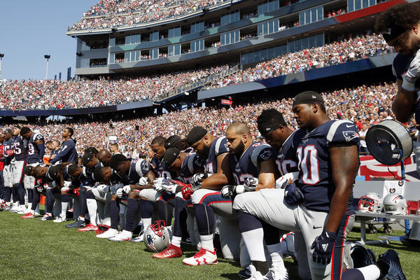 Several New England Patriots players kneel during the national anthem before a game against the Houston Texans.