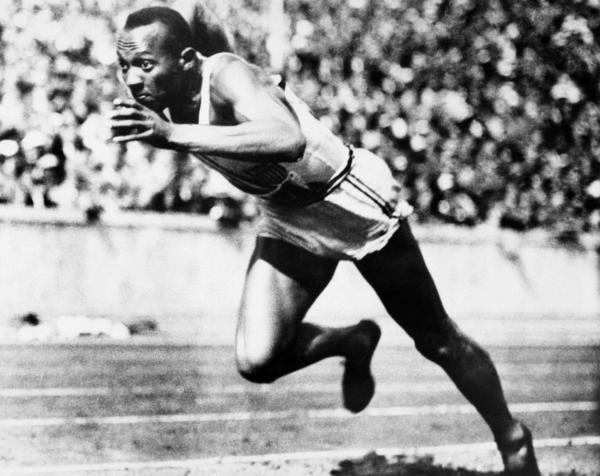 Jesse Owens competing in one of the heats of the 200-meter run at the 1936 Olympic Games in Berlin. Owens won four gold medals at games in front of Adolf Hitler.